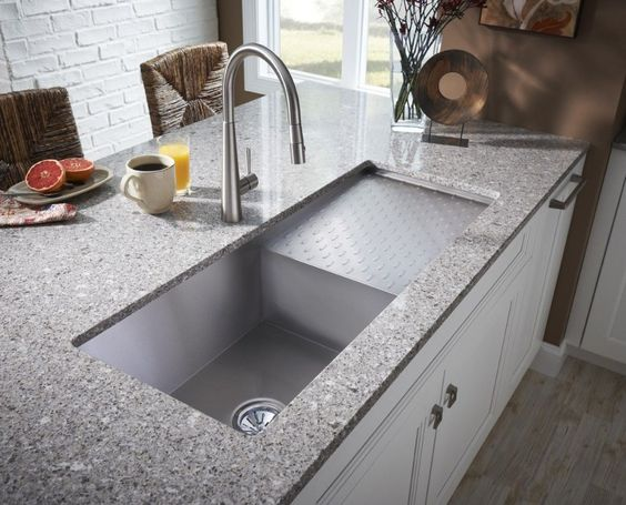 This Sink Has A Drainage Area For The Dish Strainer Integrated Into The Sink  Design.